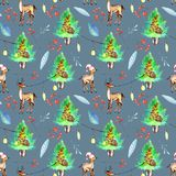 Watercolor Christmas trees, deers and festive garlands winter seamless pattern. Hand painted on a blue background, celebratory winter design Stock Photography