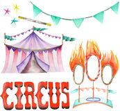 A watercolor circus set with the hand drawn elements: a garland of flags, fire rings and circus tent.  Royalty Free Stock Photos