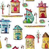 Watercolor city with fairy and cosy houses. Seamless texture with buildings, trees, and lamps. White background. Raster illustration Royalty Free Stock Image