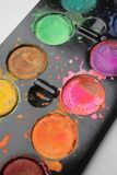 Watercolor closeup. Close-up view of multicolored watercolor paints in tray Stock Photo