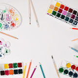 Watercolor, colour pencils, palette and brushes at white background. Flat lay, top view Stock Images
