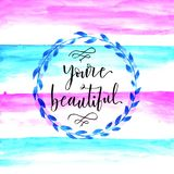 Watercolor design of you`re beautiful. Hand lettering Stock Photos