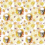 Watercolor drawing seamless background human skull for halloween with autumn yellow leaves and flowers in the eye sockets for prin. T, decoration on white Stock Photo