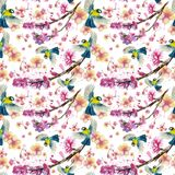 Watercolor drawing seamless pattern on the theme of spring, heat, illustration of a bird of a troop of passerine-shaped large tits. Flying, with open wings Stock Photos