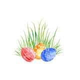 Watercolor Easter eggs at green grass Royalty Free Stock Photography