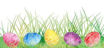Watercolor Easter eggs at green grass Royalty Free Stock Photos