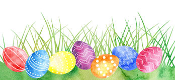 Watercolor Easter eggs at green grass Royalty Free Stock Photo