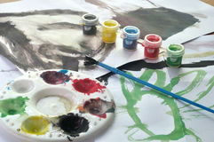 Watercolor equipment with child's paint picture Royalty Free Stock Image