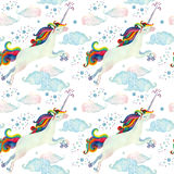 Watercolor fairy tale seamless pattern with flying unicorn, rainbow, magic clouds and rain Stock Image