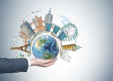 Watercolor of famous sights, planet, man hand Stock Photos