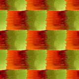 Watercolor geometric seamless pattern. Modern textile design in orange, red and green colors. Stock Images