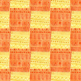 Watercolor geometrical seamless pattern. Ethnic textile texture in yellow and orange color. Fabric print design Royalty Free Stock Photo