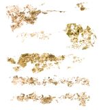 Watercolor golden brush strokes set. Golden holidays textures. Hand painted trendy illustration isolated on white