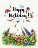 Watercolor greeting card Happy Birthday dear grandmother with flower lawn and lettering in flower frame Royalty Free Stock Photos