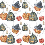 Watercolor Halloween pumpkins pattern. Hand painted carved faces pumpkins, candles and witch hat isolated on white Stock Images