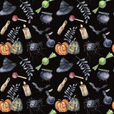 Watercolor Halloween seamless pattern. Hand painted Halloween symbols: pumpkins, witch hat, candy, spider, potion Royalty Free Stock Image