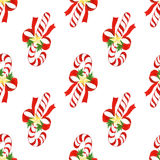 Watercolor hand drawn christmas cute pattern. seamless background with candy canes,bows,golden stars and holly leaves Royalty Free Stock Photo