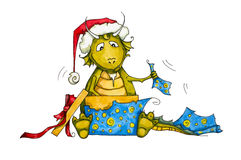 Watercolor hand drawn dragon unpacking his gift.  Royalty Free Stock Photography