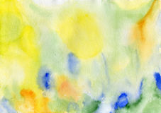 Watercolor hand painted background. In yellow, green, orange and blue colours Stock Images