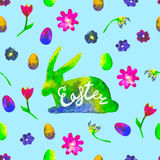 Watercolor hare silhouette with colourful eggs and flowerson blue background. Bright hand drawn illustration. Happy Easter. Royalty Free Stock Photos