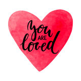Watercolor heart with you are loved inscription isolated on white. Watercolor heart with you are loved inscription Hand drawn creative calligraphy and brush pen Royalty Free Stock Photography