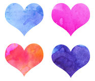Watercolor Hearts. Set of 4 hearts hand painted with watercolors. In blue, magenta, red, orange, indigo and purple Stock Photography