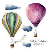 Watercolor hot air balloon set for design. Hand painted vintage air balloons with flags garlands and clouds. Illustrations isolated on white background Royalty Free Stock Photo