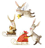 Watercolor illustration a company of magic rabbits. Watercolor illustration a company of bunnys. Children`s illustration of three funny magic rabbits on a white Royalty Free Stock Photography