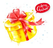 Watercolor illustration of golden color gift box. With red bow and paint splashes Royalty Free Stock Photography