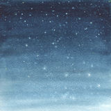 Watercolor illustration of a starry sky. Stock Images