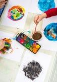 Watercolor in kindergarten Stock Photo