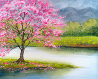 Watercolor landscape. Flowering pink tree by lake Royalty Free Stock Photos