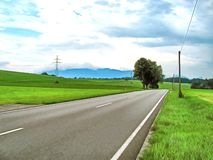 Watercolor landscape. The road to the field. Watercolor mountain landscape. The road to the field. Power lines. Clouds in the sky. Digital painting stock illustration