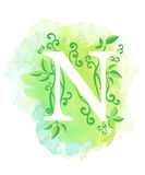 Watercolor letter calligraphy on watercolor background. Natural elements leaves curls design an element for web poster typographic Royalty Free Stock Images