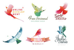 Watercolor logo templates. Colorful birds silhouettes in watercolor technique. Stock Photos