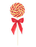 Watercolor lollipop with with red and yellow stripes and red bow Royalty Free Stock Image