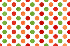 Watercolor orange, red and green polka dot background. Stock Images