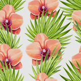 Watercolor orchid flower and palm leaves seamless pattern. Stock Image