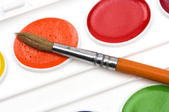 Watercolor paint and brush Stock Photo