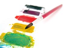 Watercolor paint with brush Royalty Free Stock Photo