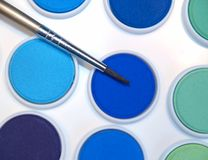 Watercolor paint with brush Stock Photography