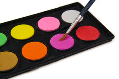 Watercolor paint and brush in black box on a white Royalty Free Stock Photography