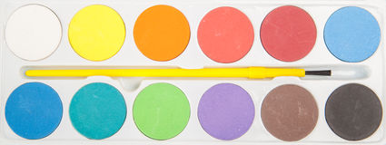 Watercolor paint and brush Stock Image