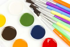 Watercolor paint and brushes Stock Photos