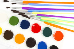 Watercolor paint and brushes Royalty Free Stock Photos