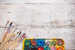 Watercolor paint and brushes Royalty Free Stock Image
