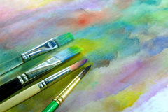 Watercolor paint brushes Stock Images