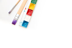 Watercolor paint and brushes  on white background Stock Photo