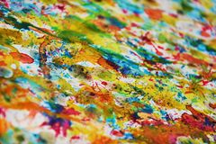 Watercolor paint colorful blurred brush strokes, vivid hues, spots. Hand made colorful waxy burnt paint blurred design with  blue, gold, white, silvery, violet Stock Photo