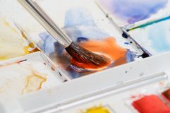 Watercolor paint mixing Royalty Free Stock Photo
